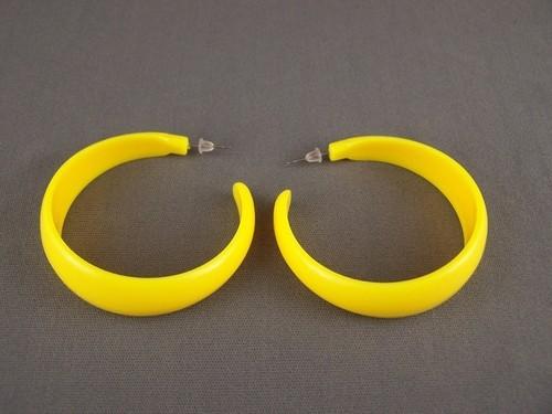 Yellow plastic hoop earrings